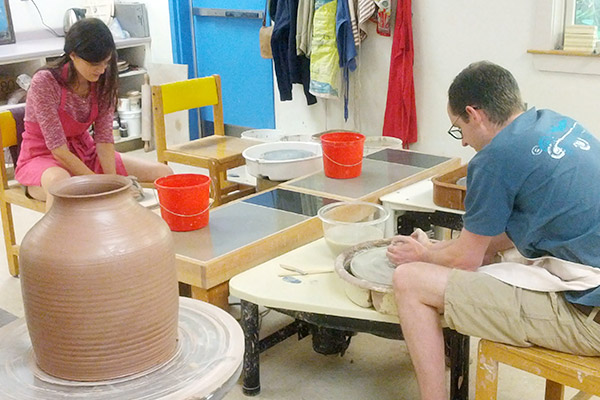 Two pottery students